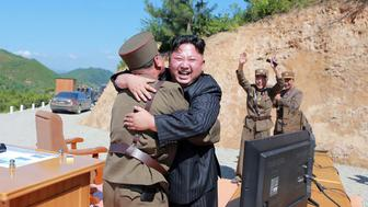 TOPSHOT - This picture taken on July 4, 2017 and released by North Korea's official Korean Central News Agency (KCNA) on July 5, 2017 shows North Korean leader Kim Jong-Un (C) celebrating the successful test-fire of the intercontinental ballistic missile Hwasong-14 at an undisclosed location. South Korea and the United States fired off missiles on July 5 simulating a precision strike against North Korea's leadership, in response to a landmark ICBM test described by Kim Jong-Un as a gift to 'American bastards'. / AFP PHOTO / KCNA VIA KNS / STR / South Korea OUT / REPUBLIC OF KOREA OUT   ---EDITORS NOTE--- RESTRICTED TO EDITORIAL USE - MANDATORY CREDIT 'AFP PHOTO/KCNA VIA KNS' - NO MARKETING NO ADVERTISING CAMPAIGNS - DISTRIBUTED AS A SERVICE TO CLIENTS THIS PICTURE WAS MADE AVAILABLE BY A THIRD PARTY. AFP CAN NOT INDEPENDENTLY VERIFY THE AUTHENTICITY, LOCATION, DATE AND CONTENT OF THIS IMAGE. THIS PHOTO IS DISTRIBUTED EXACTLY AS RECEIVED BY AFP.    /         (Photo credit should read STR/AFP/Getty Images)