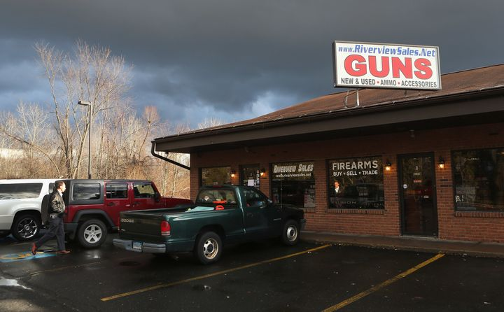 A customer approaches the closed Riverview Gun Sales shop on December 21, 2012 in East Windsor, Connecticut.