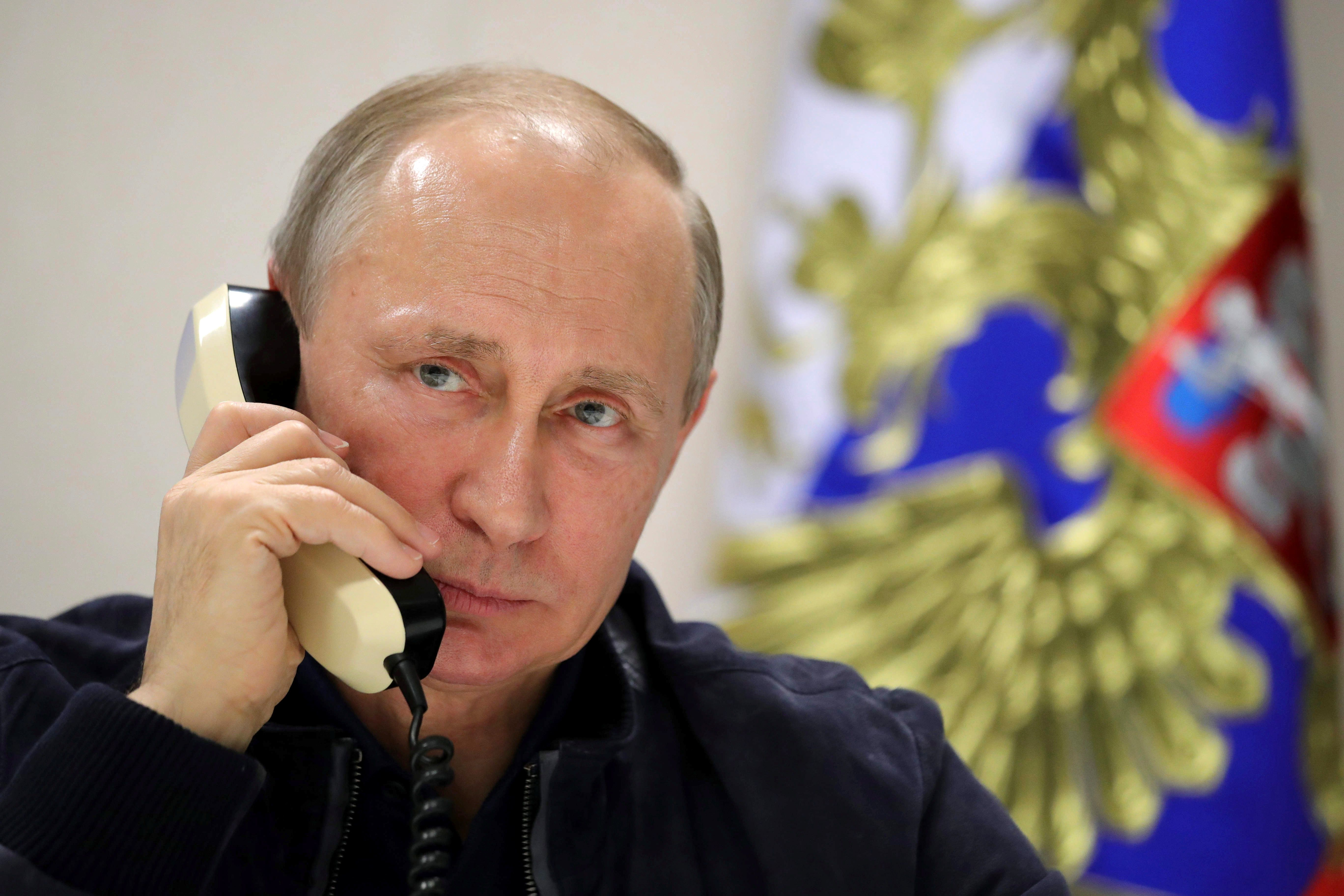 Russian President Vladimir Putin speaks over the phone with Turkish President Tayyip Erdogan while he inspects the work on the Turkish Stream gas pipeline project aboard the Pioneering Spirit pipeline-laying ship in the Black Sea near Anapa, Russia, June 23, 2017. Sputnik/Mikhail Klimentyev/Kremlin via REUTERS ATTENTION EDITORS - THIS IMAGE WAS PROVIDED BY A THIRD PARTY.