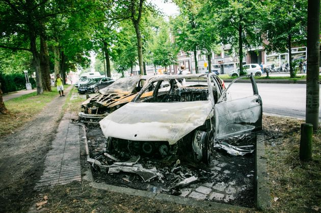 Photos show a number of burned out cars in the city following Thursday night's violent