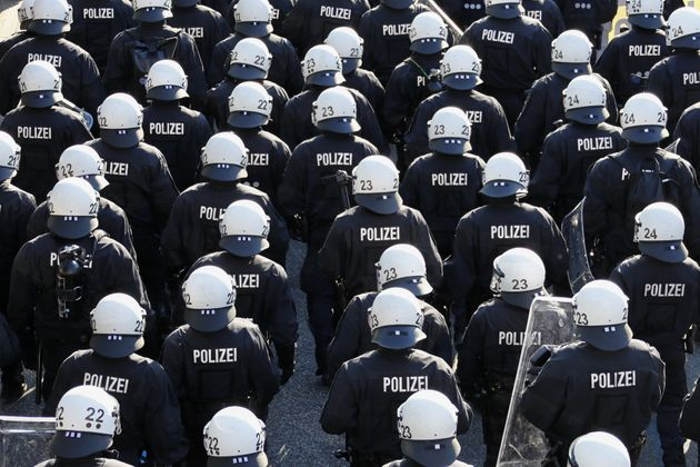 German riot police stand in front of