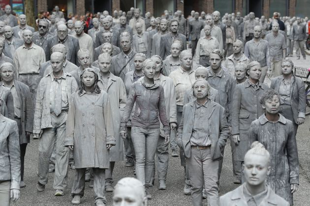 Performance artists covered themselves in clay in a 'public appeal for