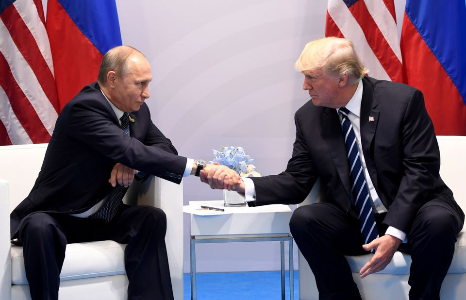 President Donald Trump and Russia's President Vladimir Putin shake hands during a meeting on the sidelines of the G20 Summit