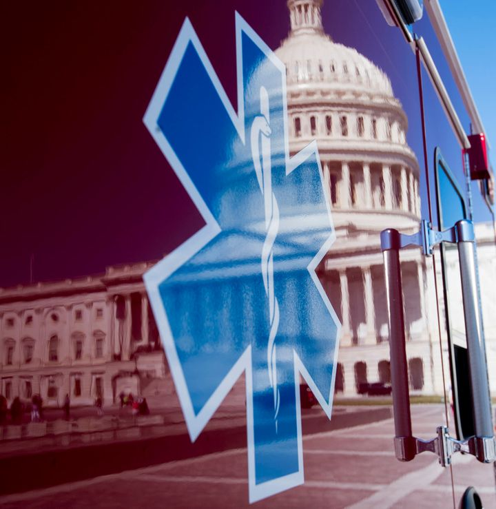 UNITED STATES – JUNE 26: The U.S. Capitol is seen in a reflection on the side of an ambulance in Washington on Monday, June