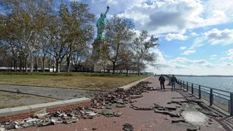 National Park Service (NPS) staff walk along Liberty Island, Statue of Liberty National Monument, after Hurricane Sandy in this NPS handout photo taken in New York November 2, 2012. (Photo by NPS/Handout/Corbis via Getty Images)
