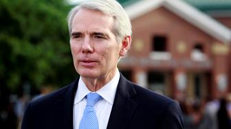 Sen. Rob Portman, R-Ohio, addresses the media outside the art center before a funeral service for Otto Warmbier, who died after his release from North Korea, at Wyoming High School in Wyoming, Ohio, U.S. June 22, 2017.  REUTERS/John Sommers II