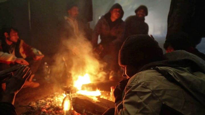 The asylum seekers, mostly Afghan men and boys, kept themselves warm by burning wood and sometimes discarded tires.