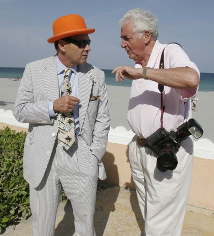 """<p>Bruce Helander speaks with Harry Benson prior to his portrait session for Benson's book, """"Palm Beach People,"""" on South Ocean Boulevard and Worth Avenue (2013). </p>"""