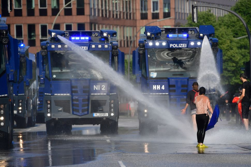 Police use water cannons on protesters.