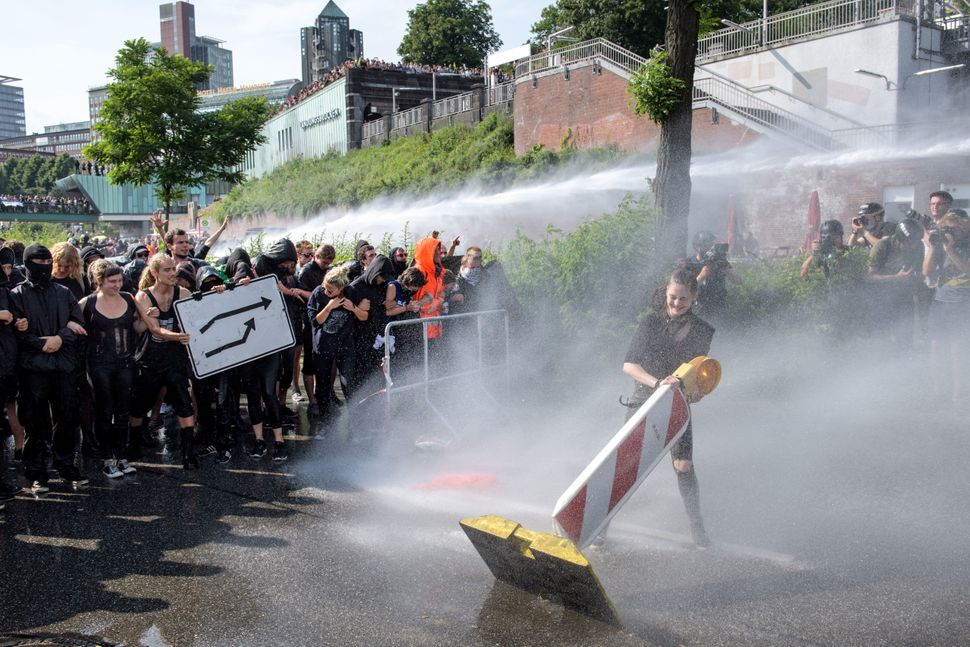 Police use water cannons against protesters.