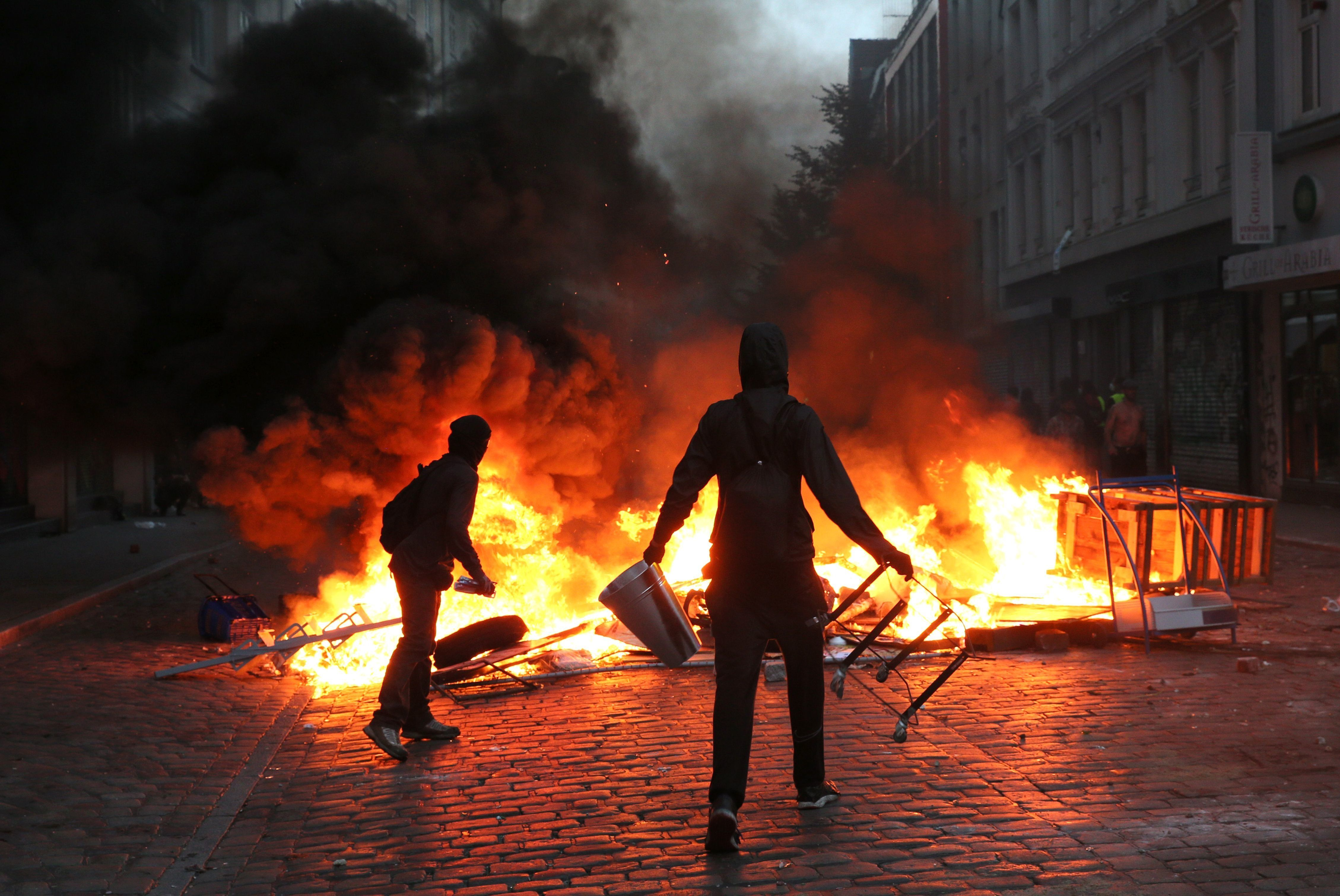 Protesters have set barricades alight on July 7, 2017 in Hamburg, northern Germany, where leaders of the world's top economies gather for a G20 summit. Protesters clashed with police and torched patrol cars in fresh violence ahead of the G20 summit, police said. German police and protestors had clashed already the day before at an anti-G20 march, with police using water cannon and tear gas to clear a hardcore of masked anti-capitalist demonstrators, AFP reporters said. / AFP PHOTO / dpa / Markus Scholz / Germany OUT        (Photo credit should read MARKUS SCHOLZ/AFP/Getty Images)