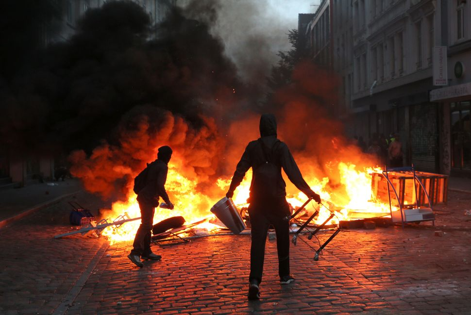 Protesters set barricadeson fire.