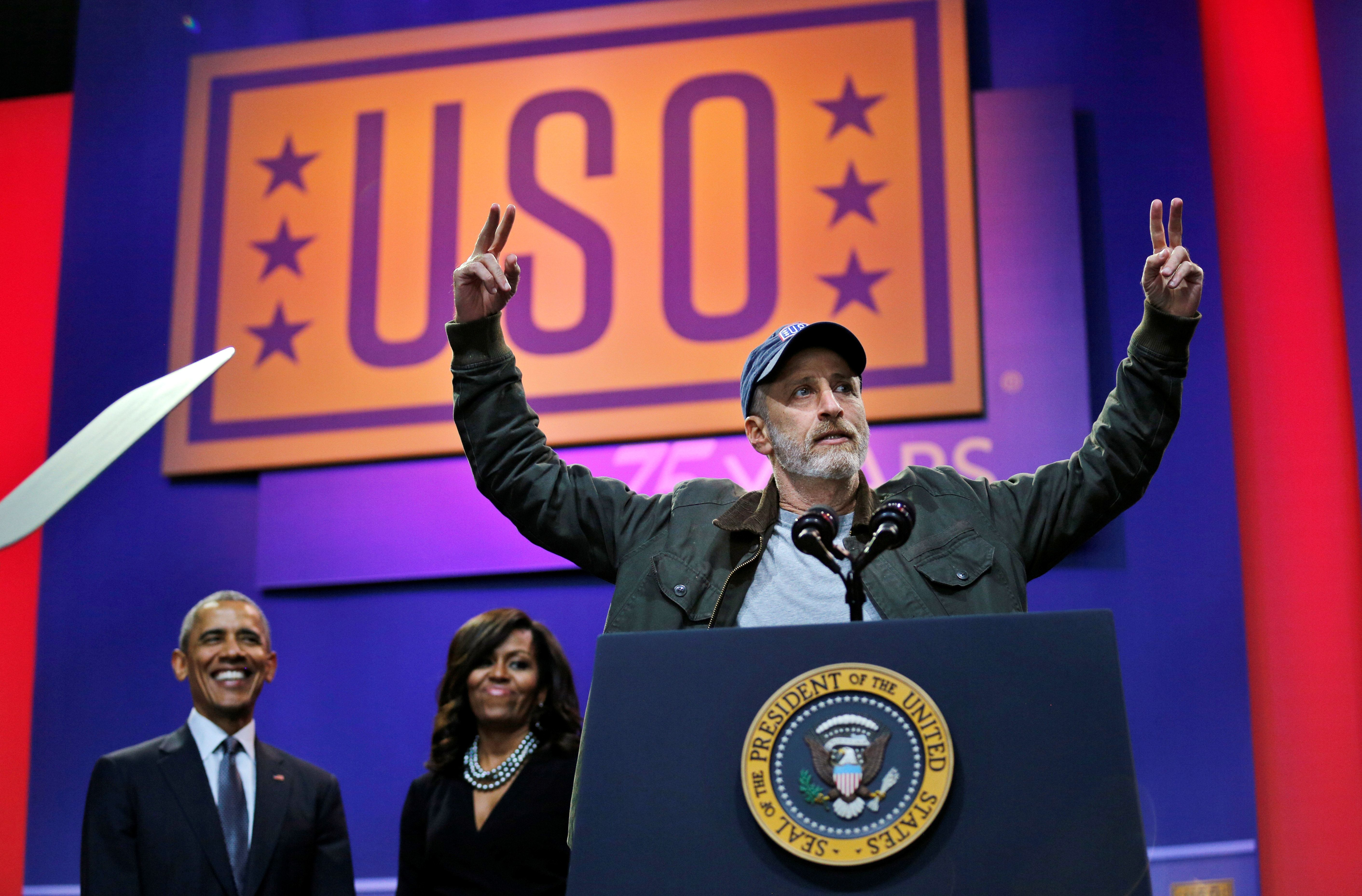 Comedian Jon Stewart attends a comedy show celebrating Military Appreciation Month as well as the 5th anniversary of Joining Forces and the 75th anniversary of the USO, accompanied by U.S. President Barack Obama and first lady Michelle Obama at Joint Base Andrews in Clinton, Maryland, U.S. May 5, 2016. REUTERS/Carlos Barria