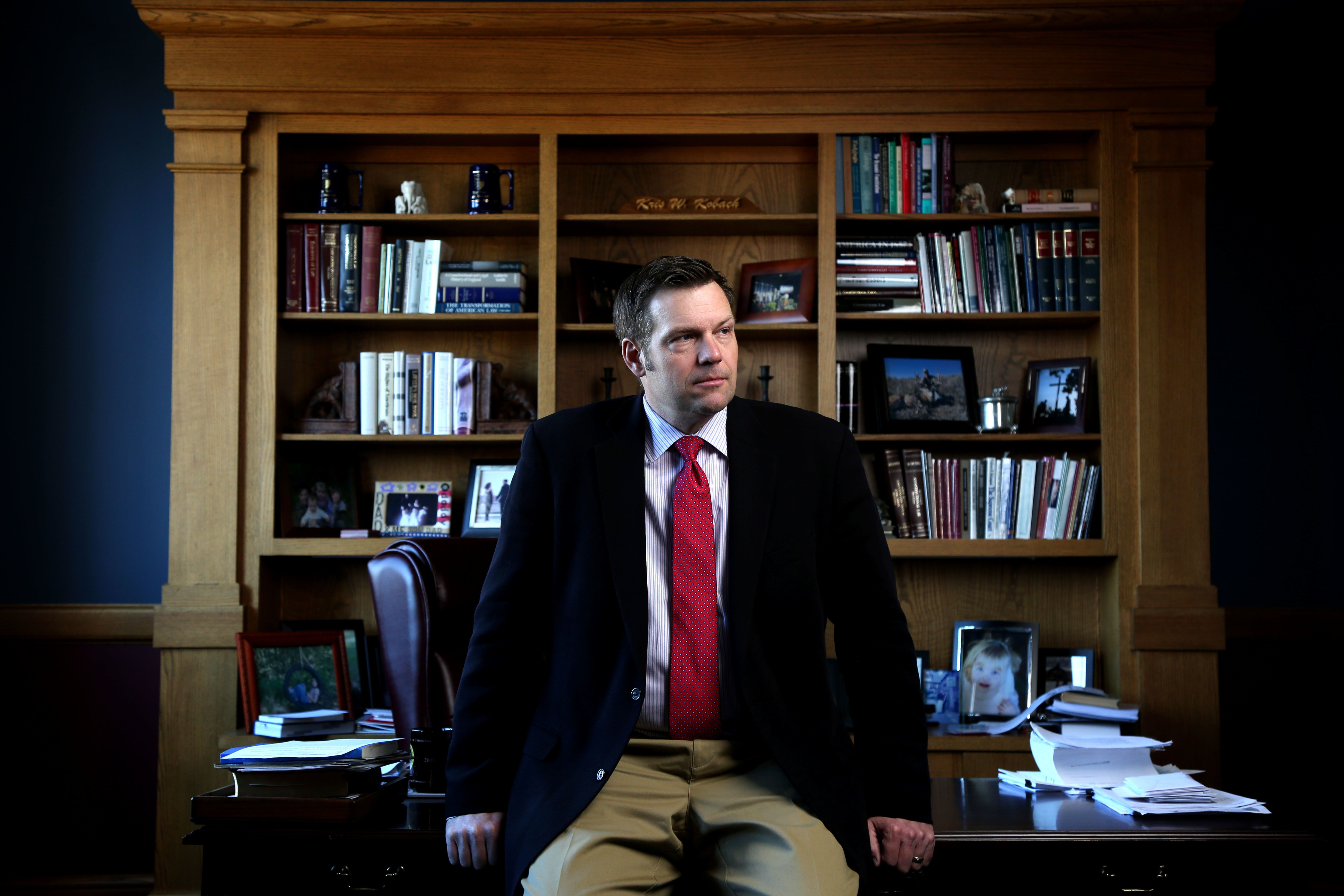 TOPEKA, KS - FEBRUARY, 17: Kansas Secretary of State Kris Kobach discusses the Kansas proof of citizenship requirements for voter registration in his office in Topeka, Ks. Wednesday February 17, 2015. (Photo by Christopher Smith/ For the Washington Post)