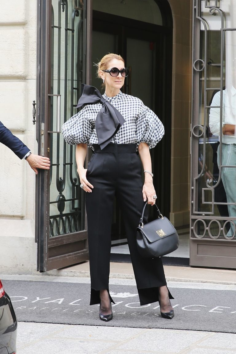 Working the head to toe monochrome look in Celine trousers and Tom Ford heels.