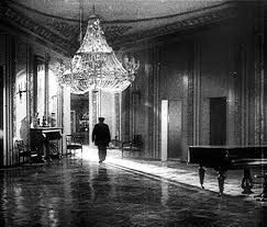 Anton (Ivan Zamychkovskyi) walks through his employer's abandoned mansion in a scene from 1927's <em><strong>Dva Dni (Two Day