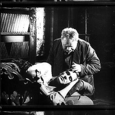 Anton (Ivan Zamychkovskyi) looks down on his estranged son turned Bolshevik soldier (Sergey Minin) in a scene from <strong><e