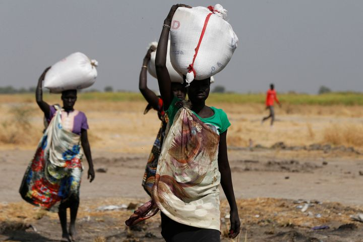 Women carry sacks of food in Nimini village, Unity State, in northern South Sudan, on Feb. 8, 2017.