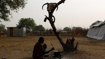 A woman cooks a meal in the town of Pibor, Boma state, east of South Sudan, February 2, 2017. Picture taken February 2, 2017. REUTERS/Siegfried Modola