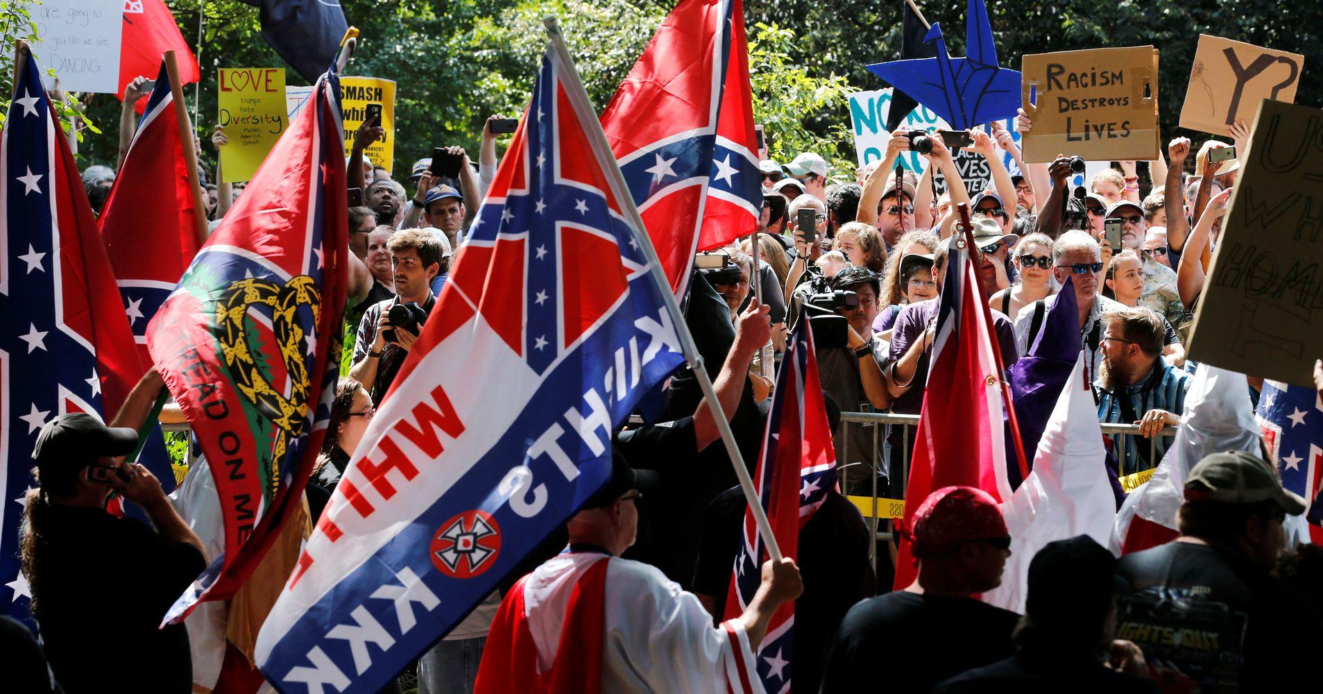 Klan Members Rally Against Removal Of Robert E. Lee Statue In Virginia