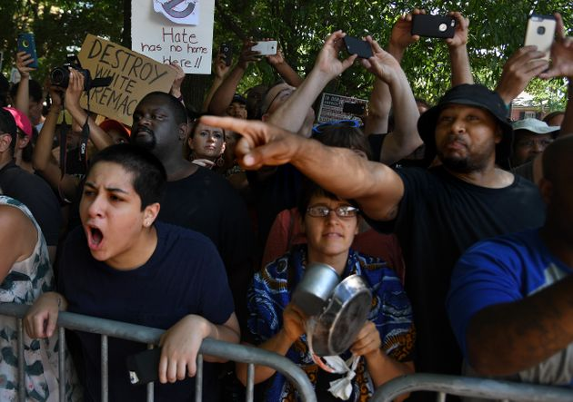 <strong> As they watched the KKK rally, anti-KKK rally goers chanted, 'Shame on you, shame...