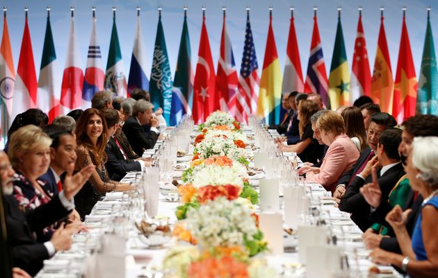 Leaders attend the G-20 summit dinner in Hamburg, Germany, on Friday. The pope criticized the U.S. and...