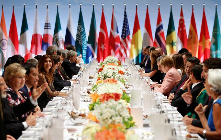 Leaders attend the G-20 summit dinner in Hamburg, Germany, on Friday. The pope criticized the U.S. and Russia, among other co