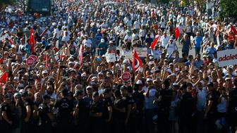 "People wait for Turkey's main opposition Republican People's Party (CHP) leader Kemal Kilicdaroglu (not pictured) as he walks on the final stage of his 25-day long protest, dubbed ""Justice March"", against the detention of the party's lawmaker Enis Berberoglu, in Istanbul, Turkey, July 9, 2017. REUTERS/Osman Orsal"