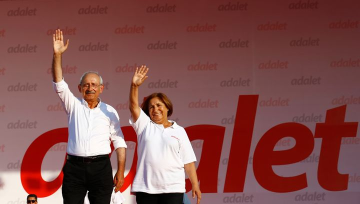 Kemal Kilicdaroglu and his wife Selvi greet people during a rally to mark the end of his 25-day long protest.