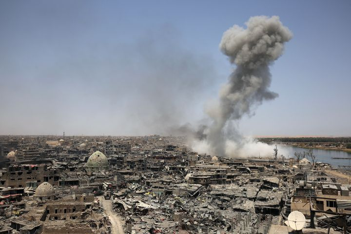 Smoke billows following an airstrike in Mosul by the U.S.-led international coalition on Sunday. Iraqi Prime Minister Haider al-Abadi congratulated the armed forces as the end of the battle for the city nears.