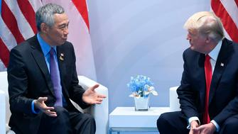 US President Donald Trump (R) and Singapore's Prime Minister Lee Hsien Loong hold a meeting on the sidelines of the G20 Summit in Hamburg, Germany, July 8, 2017. / AFP PHOTO / SAUL LOEB        (Photo credit should read SAUL LOEB/AFP/Getty Images)