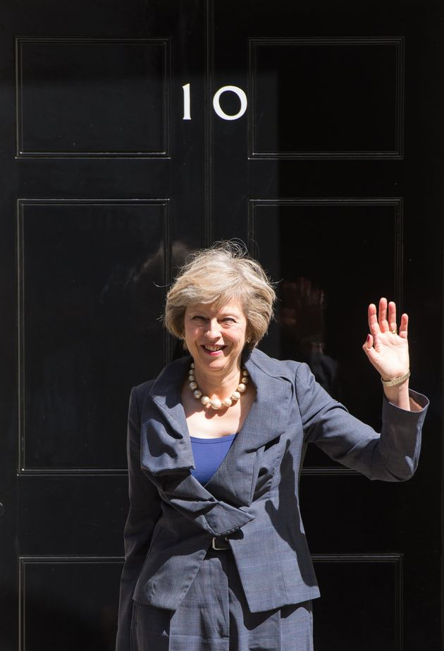 Theresa May outside 10 Downing Street a year
