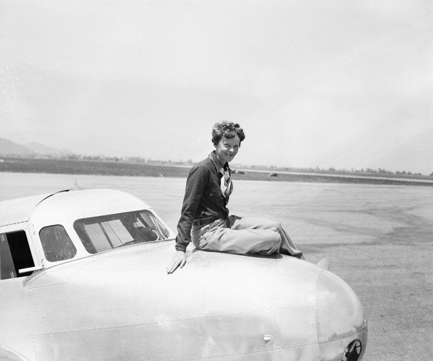 Earhartseated atop the cockpit of the twin-motored, all-metal, Lockheed-Elecktra