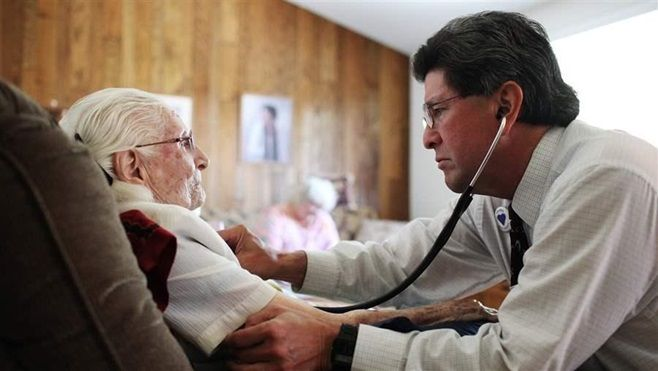 A doctor making a palliative care visit to a 103-year-old patient at her home in Santa Clarita, California. Insurance coverag