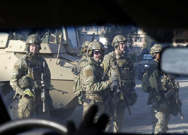 American army personnel gather at the University of Mosul during a battle with Islamic State militants in on January 18, 2017