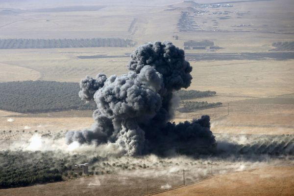 Smoke rises at Islamic State militants' positions in the town of Naweran, near Mosul on October 23, 2016.