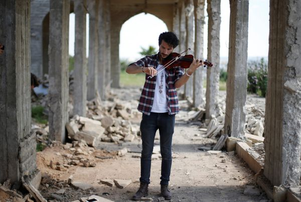 Ameen Mukdad, a violinist from Mosul who lived under ISIS's rule for two and a half years where they destroyed his musical in