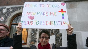 Demonstrators hold placards as they protest outside Church House, the venue of the Church of England's General Synod, in London on February 15, 2017. Leading figures in the Church of England will on Wednesday debate same-sex marriage and homosexuality, following the publication of the the House of Bishops' report published in January. / AFP / Daniel LEAL-OLIVAS        (Photo credit should read DANIEL LEAL-OLIVAS/AFP/Getty Images)