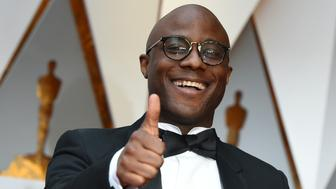 TOPSHOT - Nominee for Best Director 'Moonlight' Barry Jenkins arrives on the red carpet for the 89th Oscars on February 26, 2017 in Hollywood, California.  / AFP / VALERIE MACON        (Photo credit should read VALERIE MACON/AFP/Getty Images)