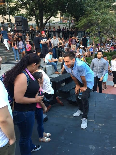 """<p>Orlando Hernandez, who plays Romeo in Trinity Rep's production of <em>Romeo and Juliet</em> for """"Shakespeare en el Verano"""" meets fellow audience members.</p>"""