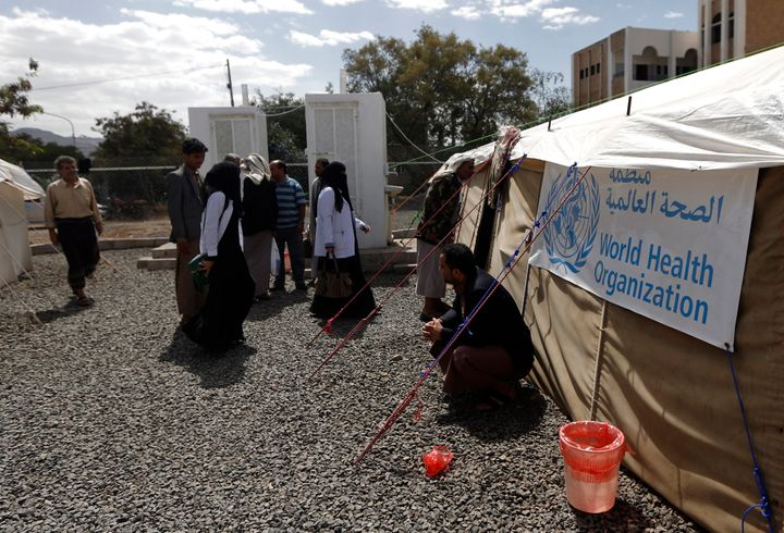 Yemenis wait outside a tent where cholera patients are receiving treatment at Sabaeen Hospital in Sanaa, Yemen, on June 13, 2