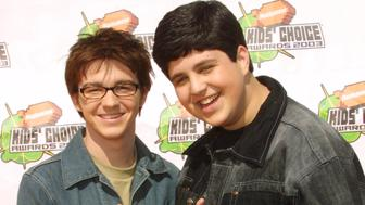 SANTA MONICA, CA - APRIL 12:  Actors Drake Bell and Josh Peck of the 'Drake and Josh' show pose during arrivals for Nickelodeon's 16th Annual Kids' Choice Awards at the Barker Hangar April 12, 2003 in Santa Monica, California.  (Photo by Frederick M. Brown/Getty Images)