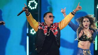 MIAMI, FL - NOVEMBER 05:  Daddy Yankee performs on stage at iHeartRadio Fiesta Latina at American Airlines Arena on November 5, 2016 in Miami, Florida.  (Photo by Jason Koerner/Getty Images for iHeartMedia)