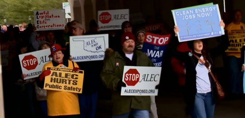 People rally outside 2013 ALEC meeting in Oklahoma.