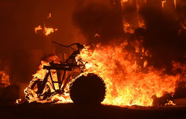 An all-terrain vehicle burns during a wildfire in a residential area near Oroville, California on July 9, 2017.