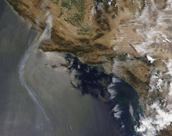 Smoke rises from fires in California in this July 8, 2017 handout satellite image.