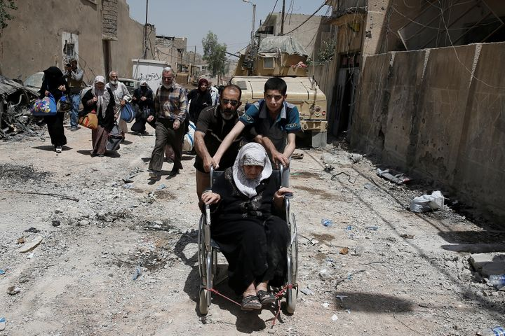 Civilians displaced by fighting between the Iraqi forces and Islamic State flee al-Zanjili district in Mosul, Iraq on June 10