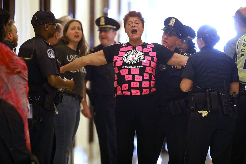 Demonstrators are arrested by U.S. Capitol police while protesting against Republican health care reform legislation outside