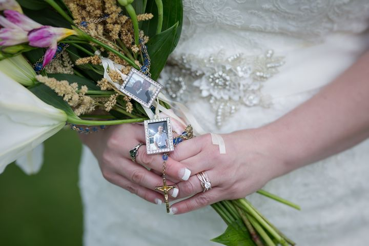 The bride attached a picture of her late son to her bouquet.