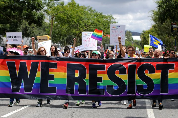 Members of the LGBTQ community protest President Donald Trump at the 2017 Pride Parade in Los Angeles.